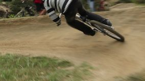 BMX racer rides circuit competition against opponent, bicycle. Stock footage stock video footage