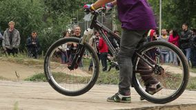 BMX racers prepare for circuit race spinning steering, start. Stock footage stock video