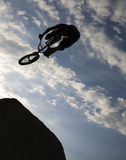 Bmx rider. Silhouette at dirt jumping Royalty Free Stock Image
