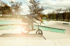 BMX rider doing tricks. Urban extreme sports. Concept royalty free stock photo