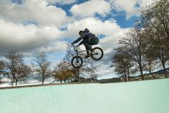 BMX rider doing tricks. Urban extreme sports. Concept royalty free stock images