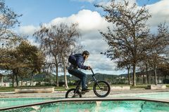 BMX rider doing tricks. Urban extreme sports. Concept stock photography