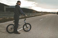 Free BMX Rider Doing Tricks. Young Man With A Bmx Bike. Extreme Sports Royalty Free Stock Images - 134846829