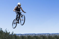 BMX rider jumping with bike Stock Image