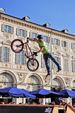 BMX rider jumps during an event of freestyle Royalty Free Stock Photo