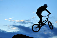 BMX rider making a bike jump Royalty Free Stock Images
