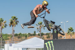 BMX rider making a bike jump during DUB Show Tour Stock Image
