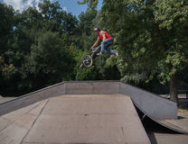 BMX rider making a bike jump Royalty Free Stock Photo