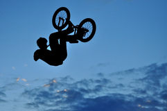 BMX rider making a bike jump Royalty Free Stock Photography