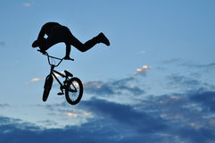 BMX rider making a bike jump Stock Image