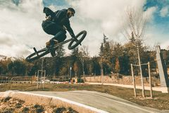 BMX rider making tricks .Guy riding a bmx bike. BMX rider making tricks.Guy riding a bmx bike and jumping royalty free stock photography