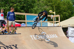 BMX rider performs a leap into ramp, Palanga, Lithuania Royalty Free Stock Photography