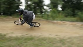 BMX rider races difficult track in helmet, spinning pedals. Stock footage stock video