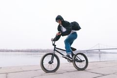 BMX rider rides a bike in the open air. BMX concept. Street style.  royalty free stock photography