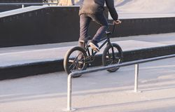 Bmx rider rides a bike on a park skate. Training of tricks on BMX.  royalty free stock photo