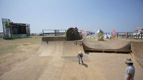 Bmx Rider rides a bike and practicing tricks in the BMX-Park stock video footage