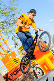 BMX rider shows skill on extreme competition Royalty Free Stock Photos