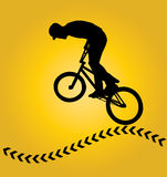 Bmx rider silhouette. Bmx rider cyclist silhouette isolated on yellow Stock Image
