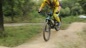 Bmx rider in yellow suit on circuit race competition fast. Stock footage stock video footage