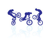 Bmx riders. Cyclist silhouette isolated on white Royalty Free Stock Photography
