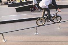 BMX riders ride a skate park on a bike and do tricks. BMX concept.  royalty free stock photo