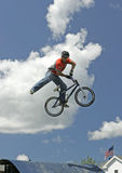 BMX Stunt Biker Hector Restrepo. Stunt biker Hector Restrepo performs in a show sponsored by Eastern Action Sports Teams in Milford, Connecticut, USA, on August royalty free stock image