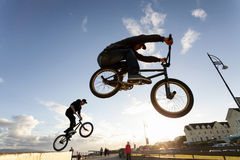 BMX stunts at the street Royalty Free Stock Images