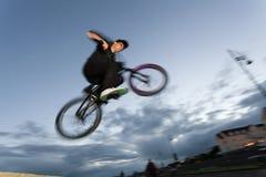 BMX stunts at the street Royalty Free Stock Photos