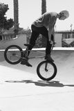 BMX Bicycle Rider. Young man performing tricks at Skaters Point in Santa Barbara 9/6/2014. This trick is called the Bunny Hop Stock Images