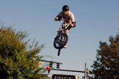 BMX vertical 360. BMX rider performs vert (vertical) stunt. He turns the bike in a full 360 on a horizontal plane. This was one jump of many in a BMX extreme Stock Photography