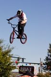 BMX vertical barspin jump. One jump of many during a BMX vert (vertical) jump exhibition. Rider is just completing a 360 degree barspin, with his hands about to Stock Photos