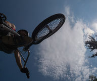 BMX vertical jump. The bike jumped over me Stock Photography