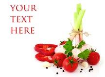 Bündel der garlicand Tomatekirsche Lizenzfreies Stockfoto