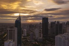 BNI Tower with skyscrapers at sunset time. JAKARTA - Indonesia. January 02, 2019: Aerial view of BNI Tower with skyscrapers at sunset time in Jakarta city stock image