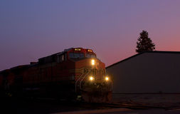BNSF Train Engine Idling At Sunset. A BNSF train idling on the tracks at sunset stock photos