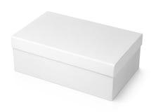 Boîte à chaussures blanche sur le blanc Photos libres de droits