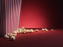 Boîte à maïs éclaté avec l'espace rouge de copie - image courante Photo stock