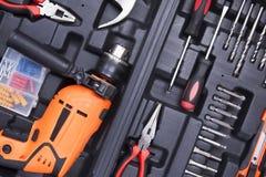 Boîte à outils noire avec des instruments de différence Photographie stock