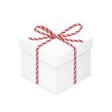 Boîte actuelle avec l'arc rouge de ficelle Images libres de droits
