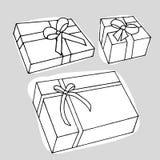 Boîte actuelle sur le fond gris Photographie stock libre de droits