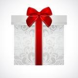 Boîte-cadeau argenté avec l'arc rouge (ruban). Présent Photographie stock