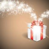 Boîte-cadeau avec la lumière rougeoyante d'étoile photographie stock