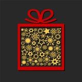 Boîte-cadeau avec les étoiles et les flocons de neige d'or sur le fond foncé, je illustration stock