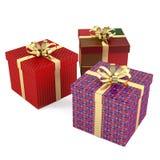 Boîte-cadeau de Noël trois d'isolement Photos libres de droits