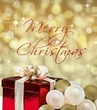 Boîte-cadeau et babioles avec le Joyeux Noël des textes photos stock
