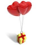 Boîte-cadeau jaune soulevé par trois ballons rouges Images libres de droits
