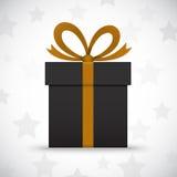 Boîte-cadeau noir sur le fond blanc avec des étoiles Photos stock