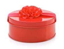 Boîte-cadeau rond en métal rouge Photo stock