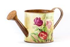 Boîte d'arrosage avec la configuration de fleur Photographie stock