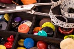 Boîte de boutons de varios Photographie stock